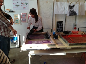 Screen-printing some rather lovely fox design bags.